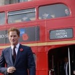 Prince Harry Rides Red Double Decker Bus in London for Poppy Day